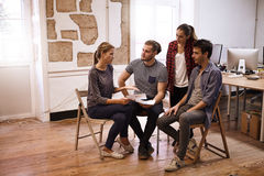 Young business team sharing fresh ideas Royalty Free Stock Images