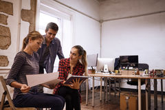 Young business team sharing their thoughts Stock Image