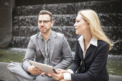 Young business team sitting down together Stock Photos