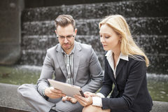 Young business team sitting down together Stock Image