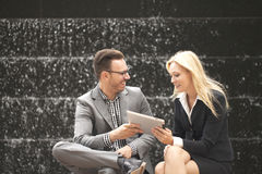 Young business team sitting down together Stock Photography