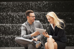 Young business team sitting down together Royalty Free Stock Photo
