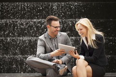 Young business team sitting down together Stock Photo