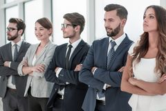 Young business team standing in a row royalty free stock photo