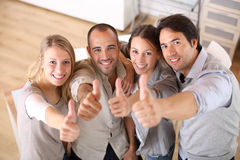 Young business team with thumbs up Royalty Free Stock Photos