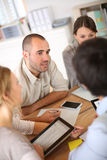 Young business team working on budget. Business people meeting for budget definition stock photography