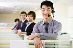 Young business team working with headset Royalty Free Stock Photo