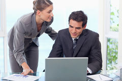 Young business team working with a laptop Stock Photos