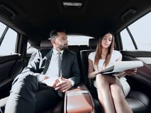 Young business team working together in the car Royalty Free Stock Photography