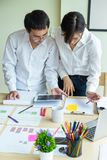 Young business teamwork working with business report document on office royalty free stock photo
