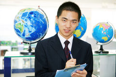 Young business with tellurion Royalty Free Stock Image