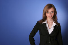 Young business woman. Image of a young business woman in a black suit, looking selfconfidently Stock Photo