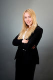 Young business woman. Arms crossed Royalty Free Stock Images