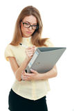 Young business woman. Or teacher writing down with a document folder in yellow shirt and glasses full leight Royalty Free Stock Photo