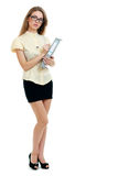 Young business woman. Or teacher with a document folder in yellow shirt and glasses full leight Royalty Free Stock Images