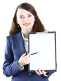 Young business woman. Portrait of a cute young business woman with the work plan smiling Royalty Free Stock Photo