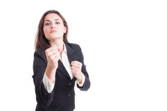 Young business woman acting aggressive showing fists Stock Photography
