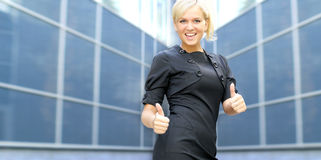 A young business woman acting successfully Stock Photo