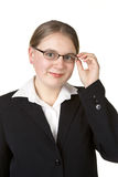 Young business woman adjusting glasses Royalty Free Stock Image