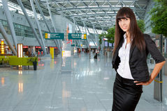 Young business woman in airport. Young business woman on the background of a modern airport Royalty Free Stock Images