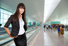 Young business woman in airport. Young business woman on the background of a modern airport Stock Photos