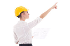 Young business woman architect in yellow builder helmet with bui Royalty Free Stock Images
