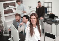 Young business woman on the background of the business team. stock images