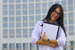 Young business woman on background of skyscraper Royalty Free Stock Photos