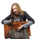 Young business woman with bag and suitcase Stock Images