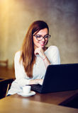 Young business woman. Beautiful young business woman using lap top Stock Photography