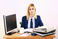 Young Business Woman Behind Desk Stock Photo