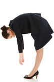 Young business woman bending down. Young business woman bending down and looking Stock Photos
