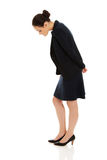 Young business woman bending down. Royalty Free Stock Photo