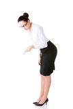 Young business woman bending down and looking. Royalty Free Stock Images
