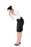 Young business woman bending down and looking. Royalty Free Stock Image