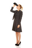 Young business woman with a binocular Stock Image