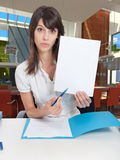 Young business woman with blank document Royalty Free Stock Image