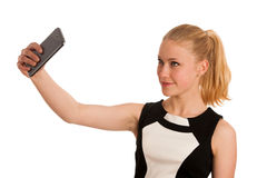 Young business woman with blond hair making selfie isolated over Stock Photography