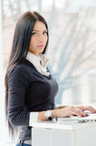 Young business woman with blue eyes using laptop PC at office Royalty Free Stock Photo