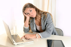 Young Business Woman boring at work Royalty Free Stock Photo