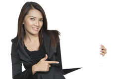 Young business woman brunette gesture attractive showing blank s. Business woman happy young pretty closeup attractive brunette standing smiling positive showing Stock Photography