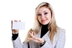 Young business woman with business card. On a white background Royalty Free Stock Photo