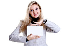 Young business woman with business card. On a white background Stock Photos