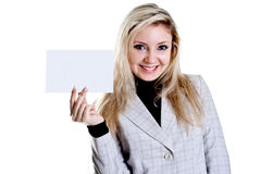 Young business woman with business card. On a white background Royalty Free Stock Photography