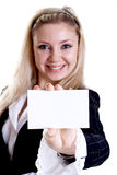 Young business woman with business card. On a white background Royalty Free Stock Photos