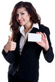 Young business woman with business card. On a white background Stock Photography