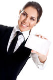 Young business woman with business card. On a white background Royalty Free Stock Image