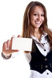 Young business woman with business card. On a white background Royalty Free Stock Images