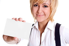 Young business woman with business card. On a white background Stock Image