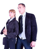Young business woman and business man posing, stock photos